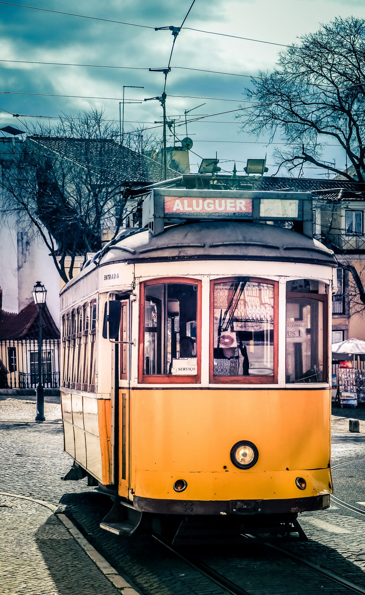 Historic Tram in Lisbon with dramatic sky